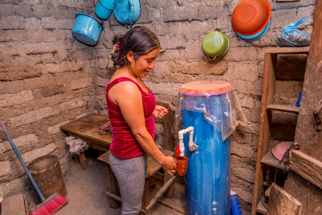 Claudia Ramos, from La Cruz, Guatemala using a bio-sand water filter.