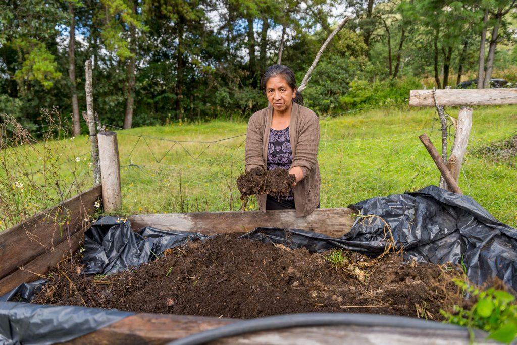 Porfilia Ramos, from La Cruz, with her organic fertilizer made from vermi-compost.